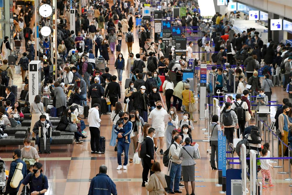 People visit at a departure lobby of Haneda airport in Tokyo Thursday, April 29, 2021, at the start of the country's