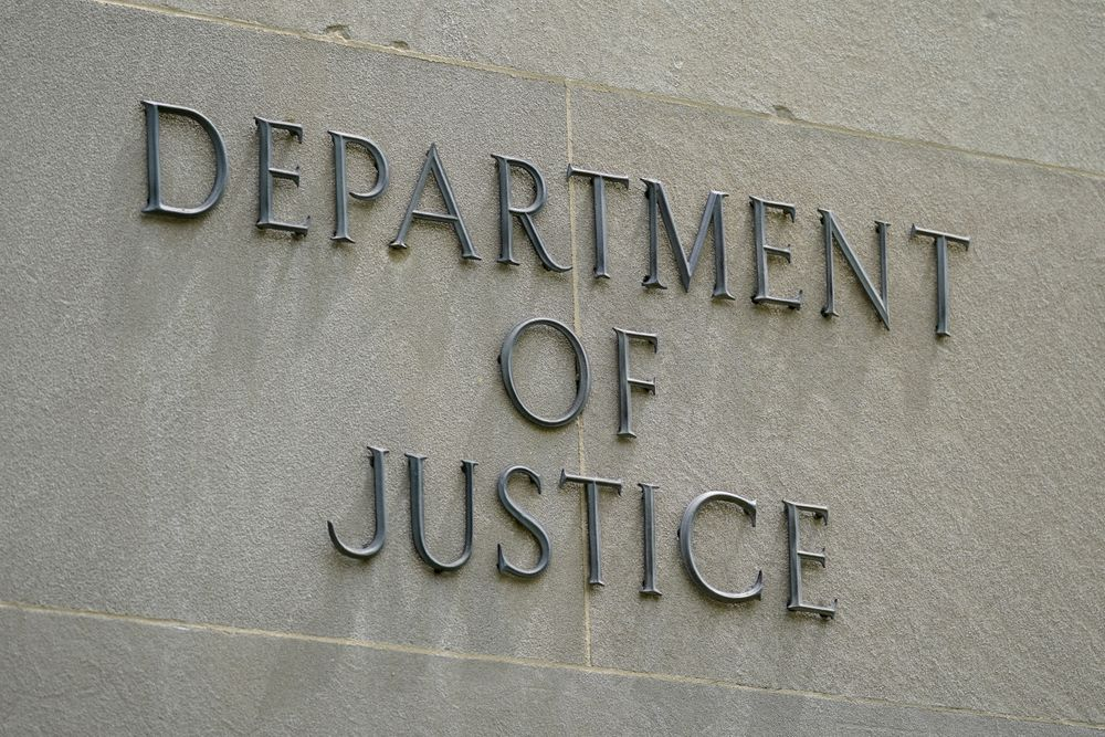 FILE - This May 4, 2021 file photo shows a sign outside the Robert F. Kennedy Department of Justice building in Washington.  President Joe Biden is nominating eight new leaders for U.S. attorney positions across the country, including in the office overseeing the prosecutions of hundreds of defendants charged in the Jan. 6 insurrection at the Capitol.  The nominees announced by the White House on Monday come as the Justice Department is continuing to round out its leadership team under Attorney General Merrick Garland, who traveled to Chicago last week to announce an initiative to crack down on gun trafficking corridors. (AP Photo/Patrick Semansky)
