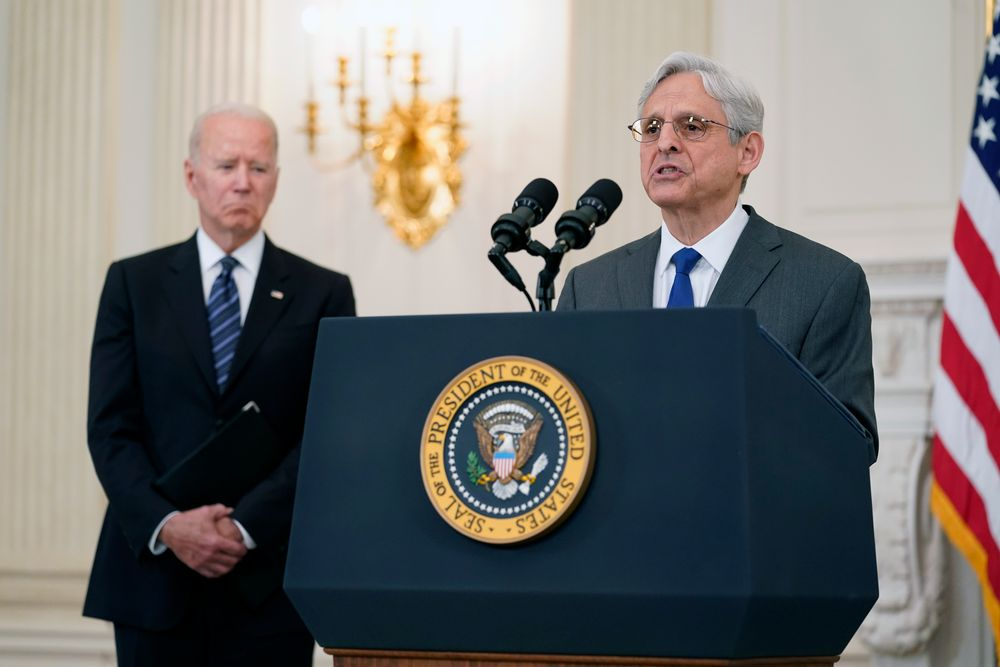 FILE - In this June 23, 2021 file photo, President Joe Biden listens as Attorney General Merrick Garland speaks during an event in the State Dining room of the White House in Washington to discuss gun crime prevention strategy. Garland traveled to Chicago last week to announce an initiative to crack down on violent crime and gun trafficking. The Justice Department's 93 U.S. attorneys are likely to be central to that effort.(AP Photo/Susan Walsh)