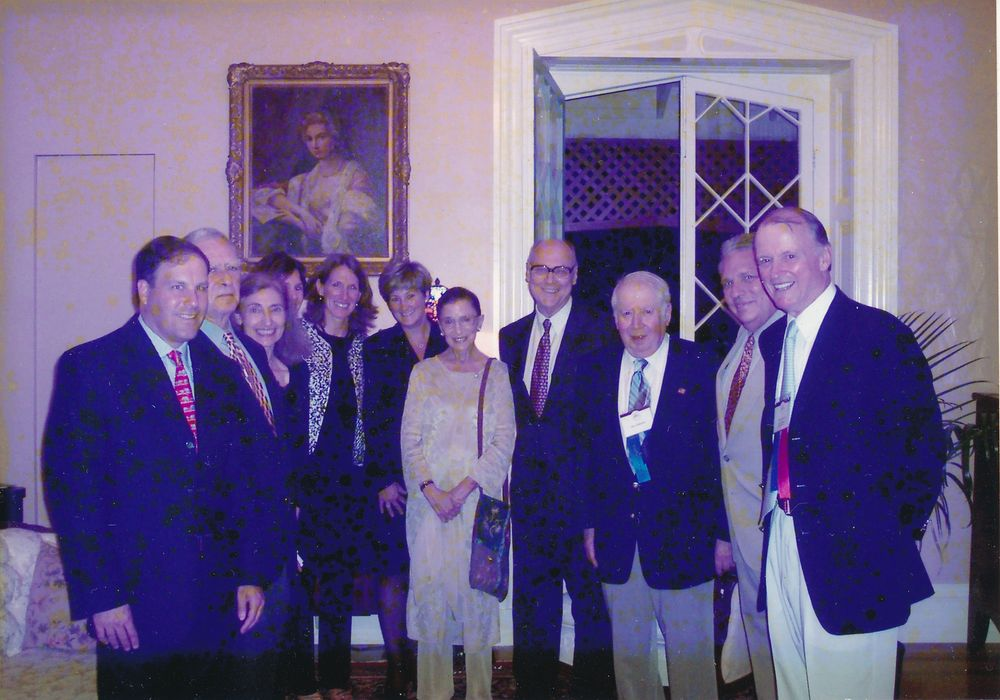 Justice Ruth Bader Ginsburg and her husband, Martin Ginsburg, center, during their visit to Newport in 2004.