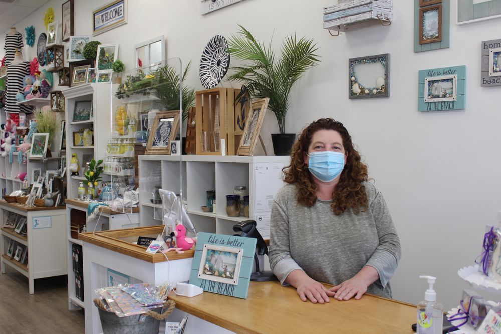 India Kenyon, the owner of Cutie Curls Boutique in Newport, said she plans to continue asking customers to wear masks until a higher proportion of Rhode Islanders are vaccinated.