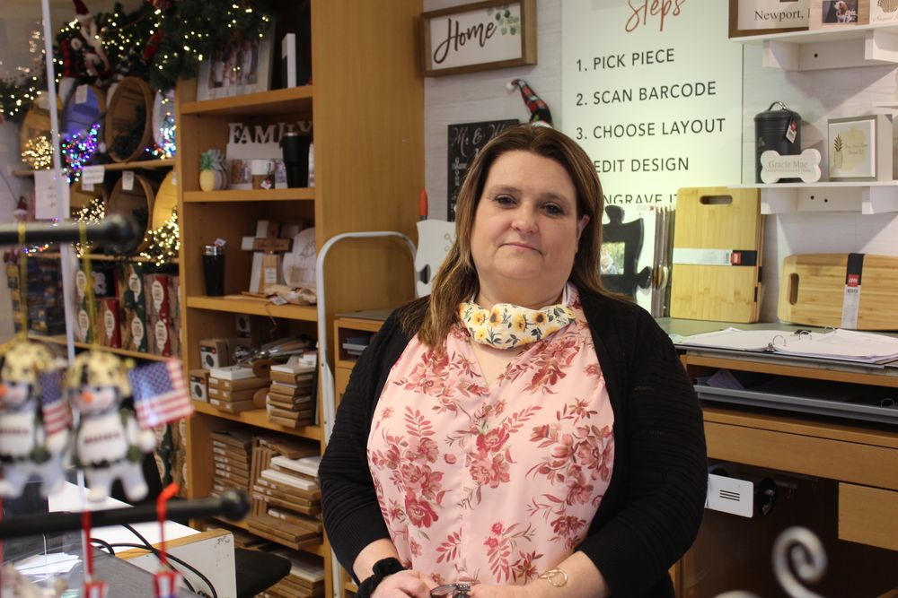 Fully vaccinated customers can now shop maskless at A Christmas to Remember, a holiday decoration store in Newport. Owner Michele Duffy said, however, that most people were continuing to put masks on when they entered the store Tuesday morning.