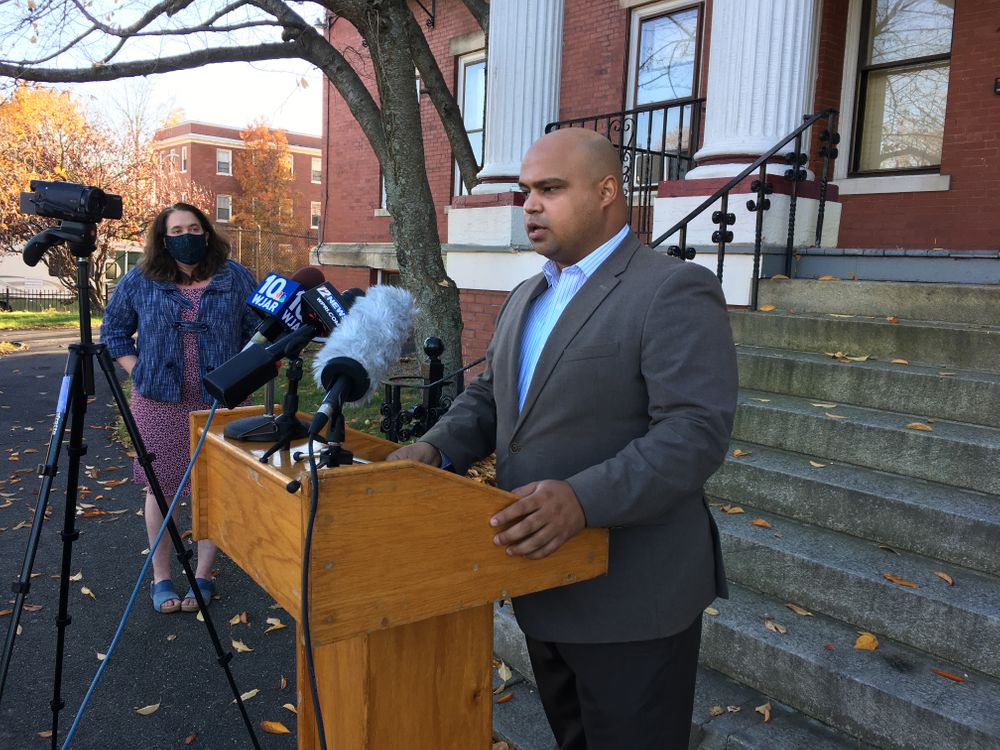Jose Batista spoke in Providence on Tuesday, November 10. City councilor Rachel Miller (left) voiced her support of Batista and of PERA's work.