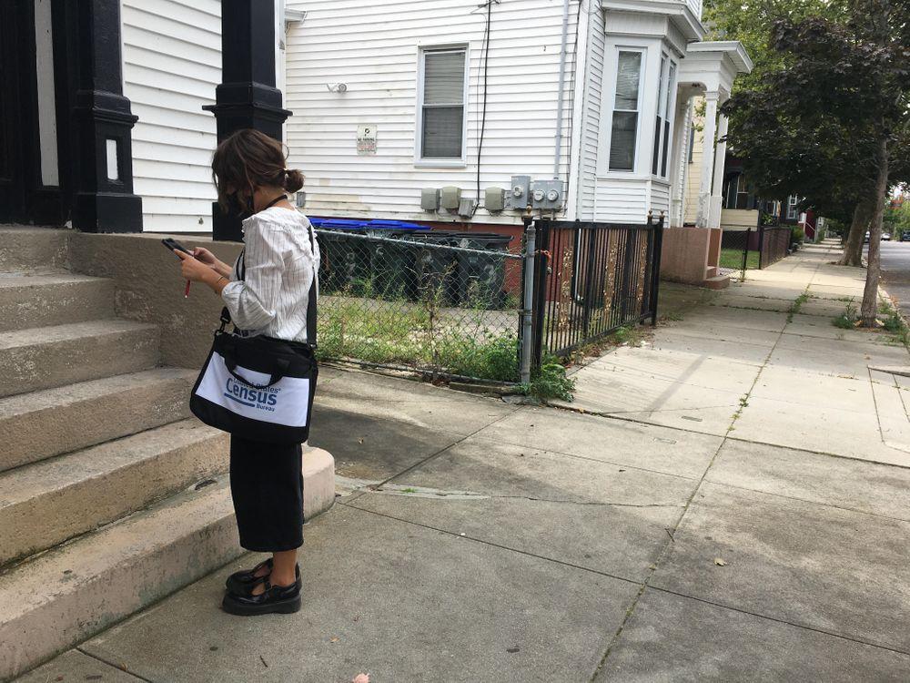A Census Bureau worker goes door to door in Providence, September 10 2020.
