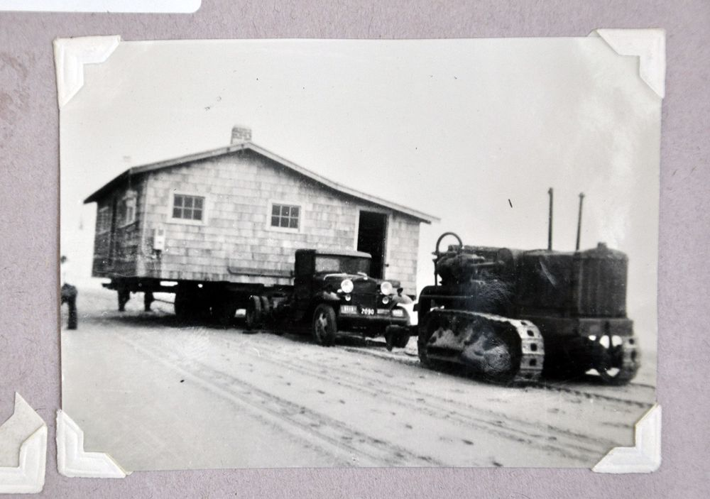 Barbara Coon's family home is moved off the barrier beach on a flatbed truck after the Hurricane of 1938.