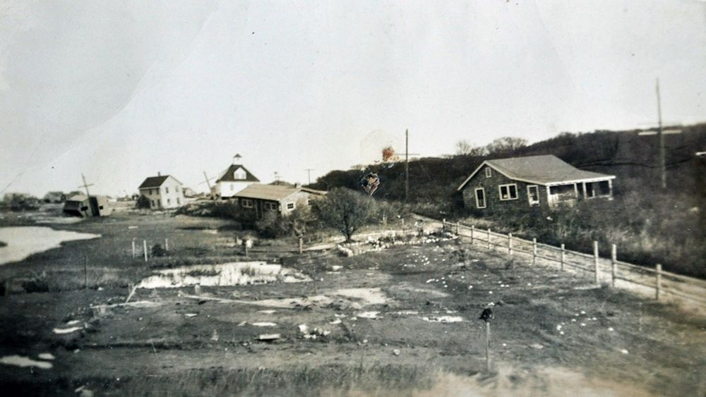 Barbara Coon's family home is pictured at center, moved some 50 yards by surging ocean water during the Hurricane of 1938.