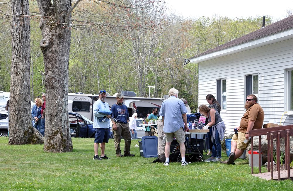 Members of the Rhode Island Mobile Sportfishermen gather for their annual meeting at a property they own in the Westerly woods.
