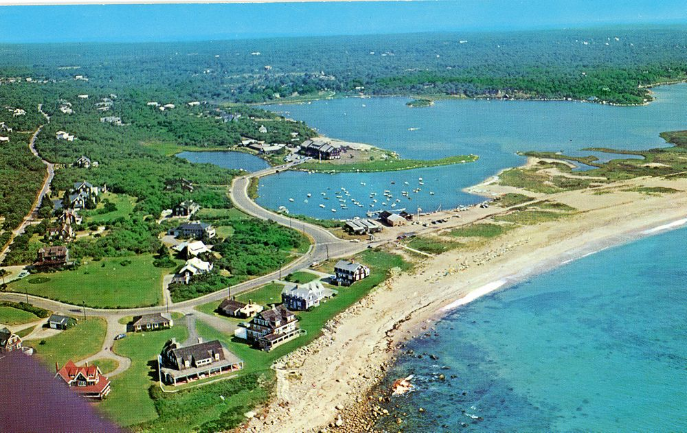 An aerial shot from circa 1995 shows the beginning of the barrier beach where a now-blocked path is being reviewed by the Rhode Island Coastal Resources Management Council.
