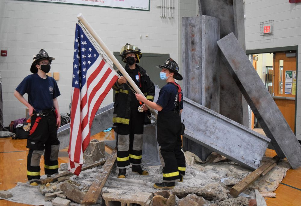 Chris Stanley's students at Ponaganset High School reenacted Thomas E. Franklin's photograph of the flag raising at Ground Zero.