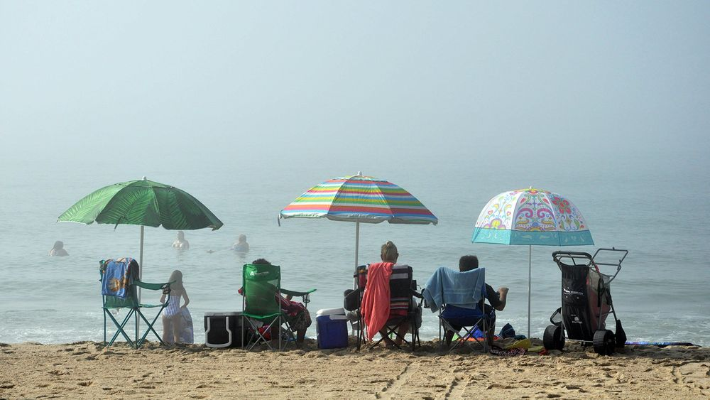 Visitors at Misquamicut State Beach in Westerly on Saturday, July 18, 2020.
