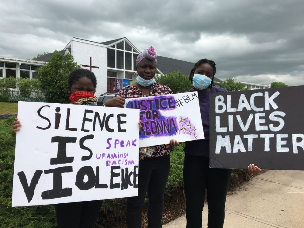 Ndeye Diallo and her daughters, Aby, 15, and Fatimah, 11, joined neighbors in Barrington, R.I. at a protest on Sunday.