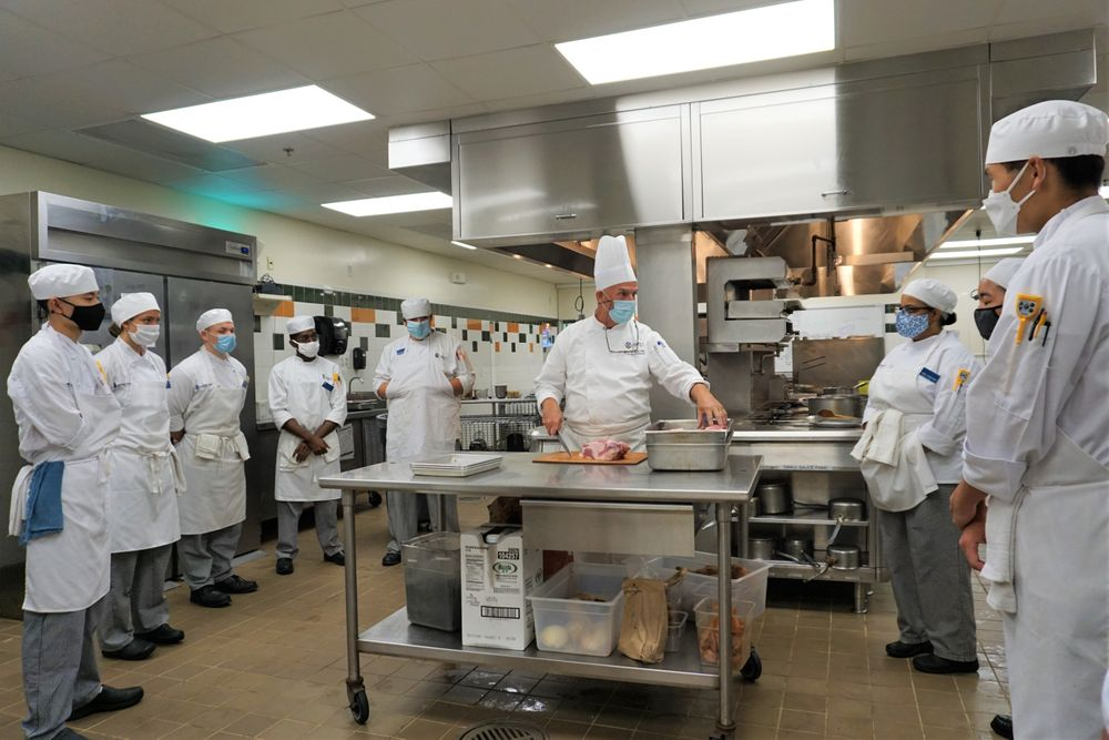 Chef John Dion demonstrates for students taking in-person courses on campus at Johnson and Wales this summer.