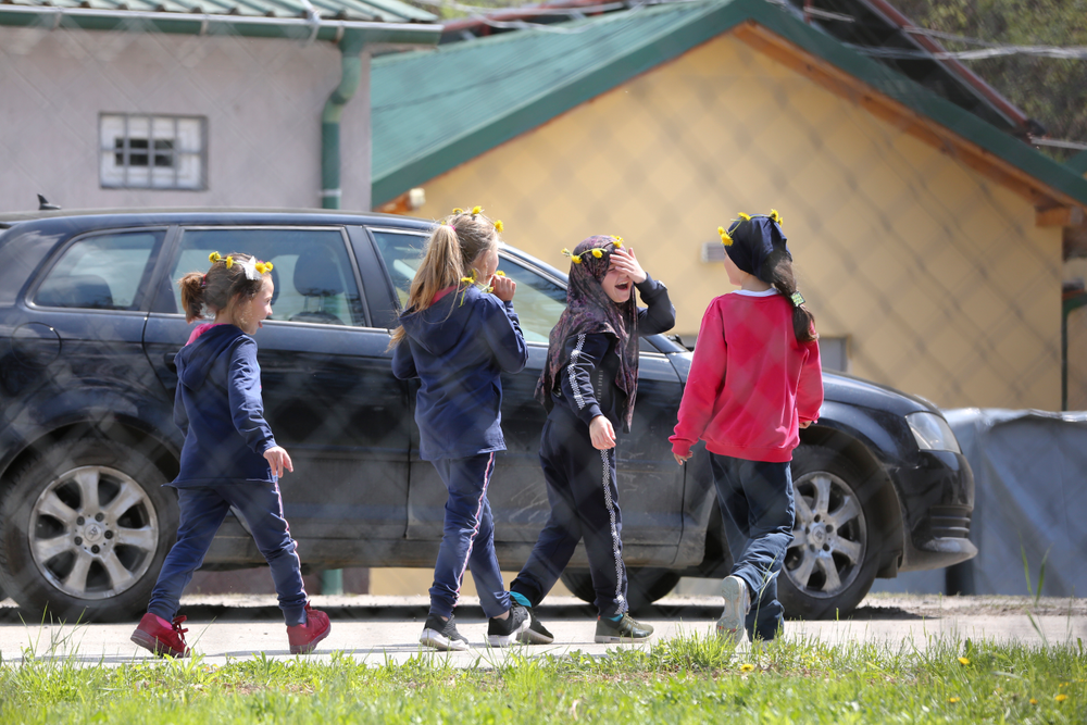 A group of children walk inside a detention center where authorities have brought back from Syria 110 Kosovar citizens, mostly women and children in the village of Vranidol on Sunday, April 20, 2019.  Four suspected fighters have been arrested, but other returnees will be cared for, before being sent to homes over the coming days, according to Justice Minister Abelard Tahiri.(AP Photo/Visar Kryeziu)