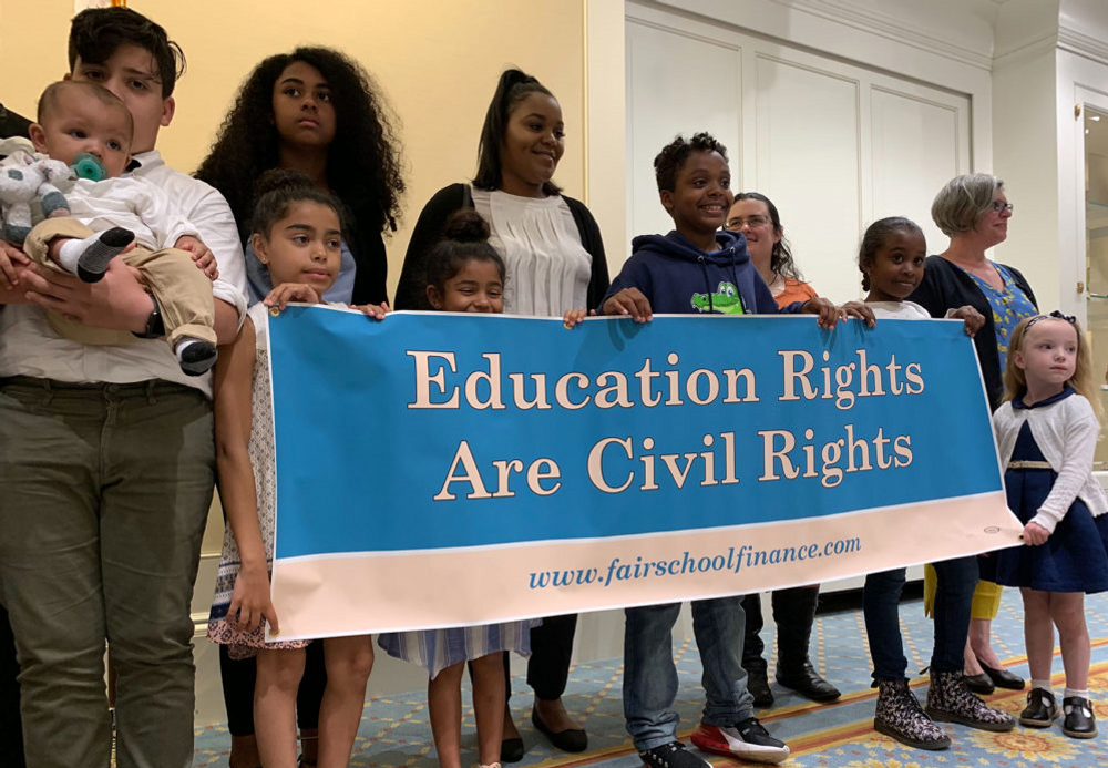 Parents and students from seven Massachusetts communities say they filed the lawsuit because legislative efforts to get more funding for their schools are taking too long and don't go far enough.