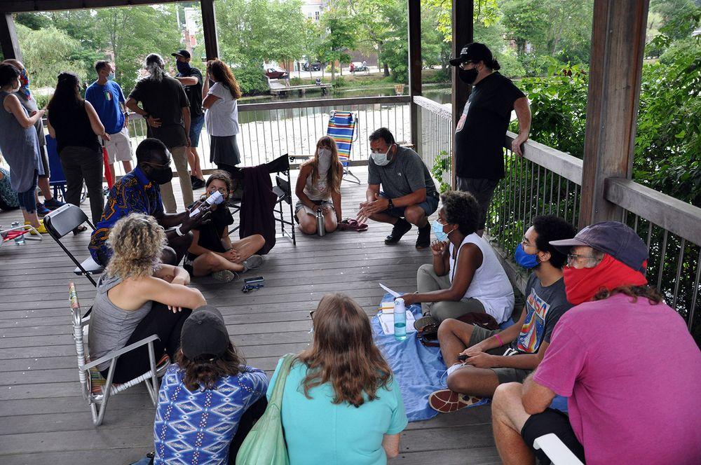 TASK members break up into smaller groups at the gazebo behind Wakefield Elementary School on Aug. 2, 2020.