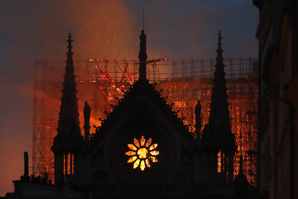 Flames and smoke rise from Notre Dame cathedral as it burns in Paris, Monday, April 15, 2019.