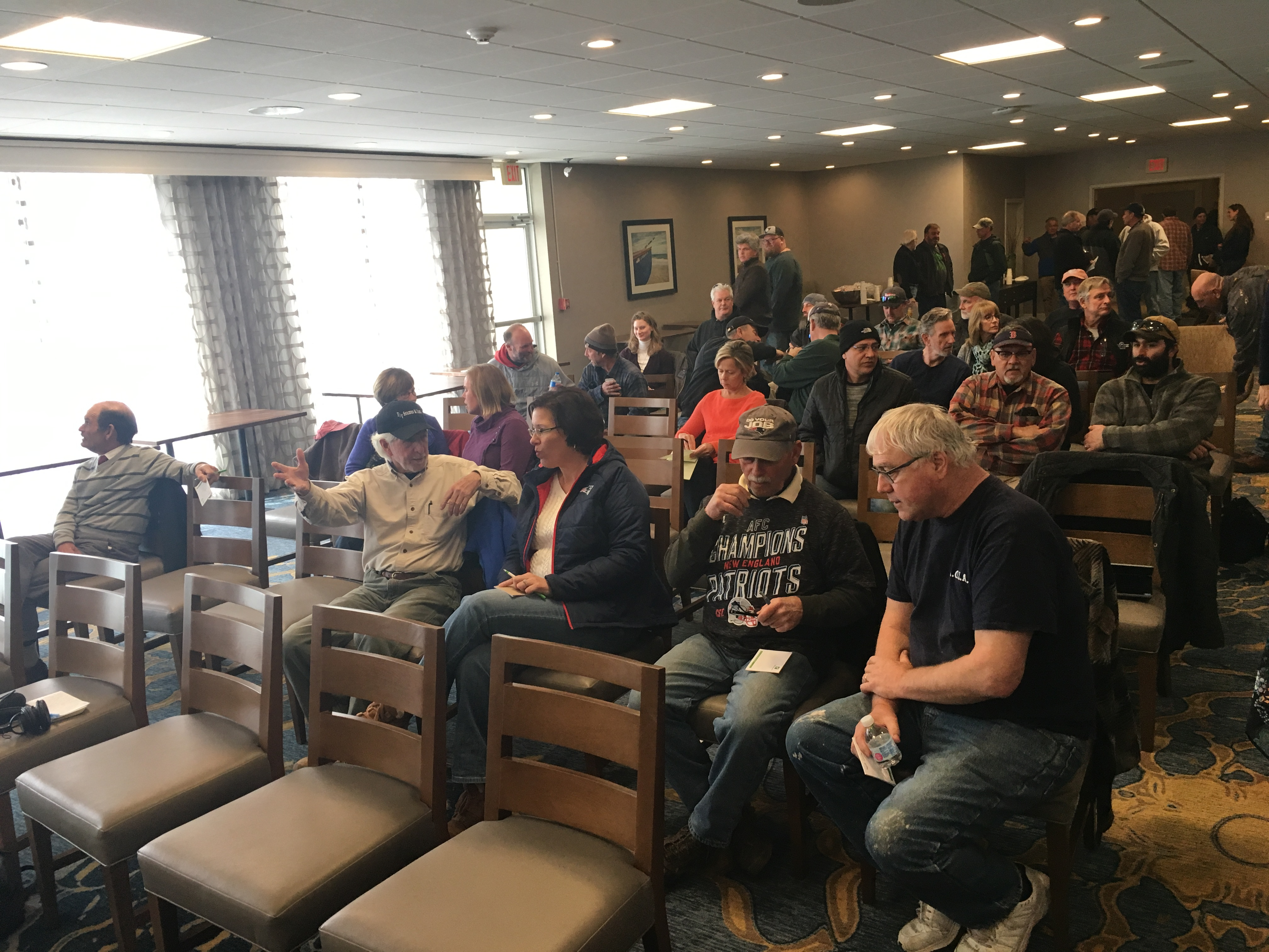 Members of the commercial fishing industry gather at a hotel in South Kingstown Saturday during a fishermen's advisory board meeting to accept or reject compensation from Vineyard Wind.