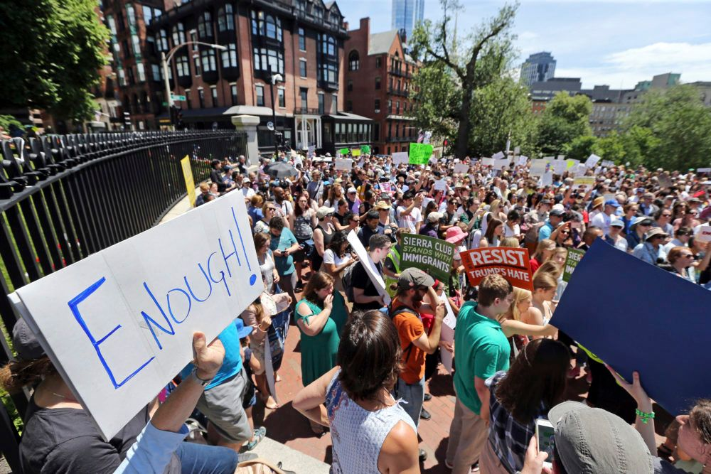People rally outside the State House in Boston on June 20, 2018, to protest how immigrants are being treated both on the border with Mexico and in Massachusetts.