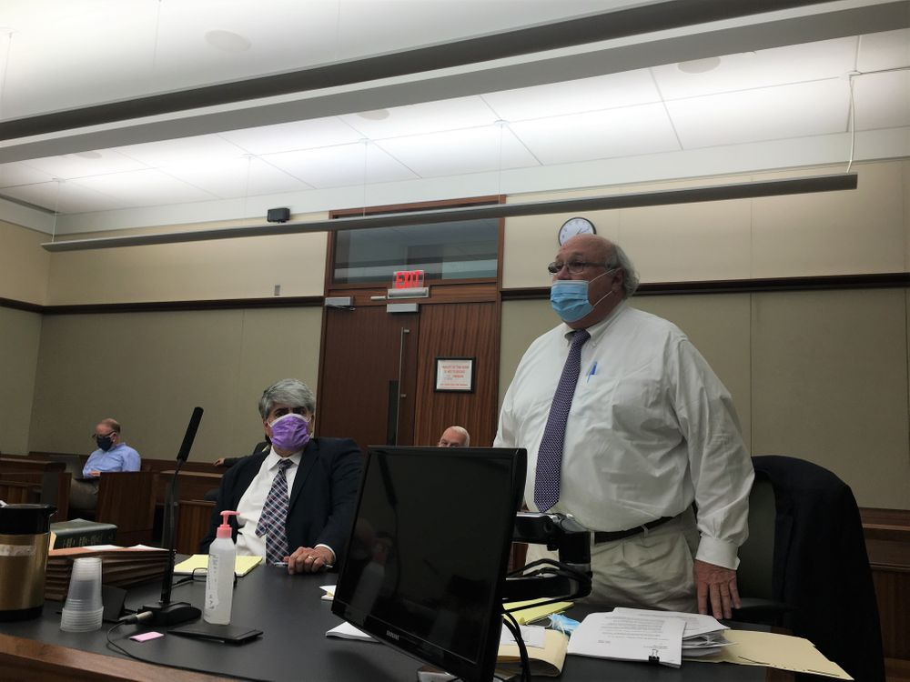 Since 2006, the CRMC and Champlin's Realty Associates have fought in court over a proposed marina expansion. But in July, attorneys Anthony DeSisto (left), representing the CRMC, and Robert Goldberg, representing Champlin's, found themselves on the same side of the courtroom, defending a deal reached through mediation.