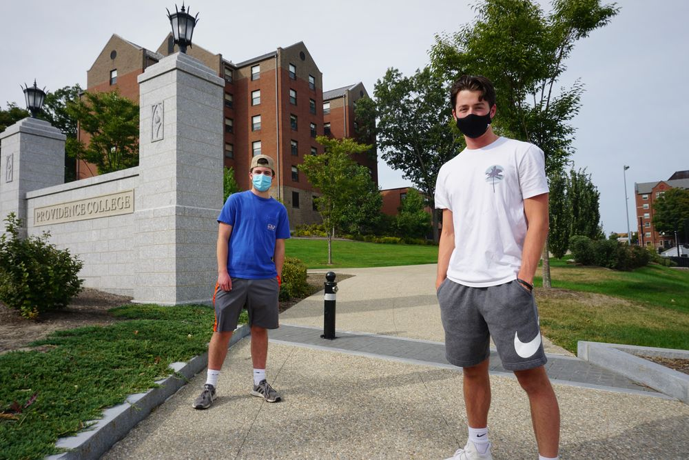 Providence College students Kevin Rockwal and Shawn Soucie, both juniors, on their way to get tested for COVID-19.