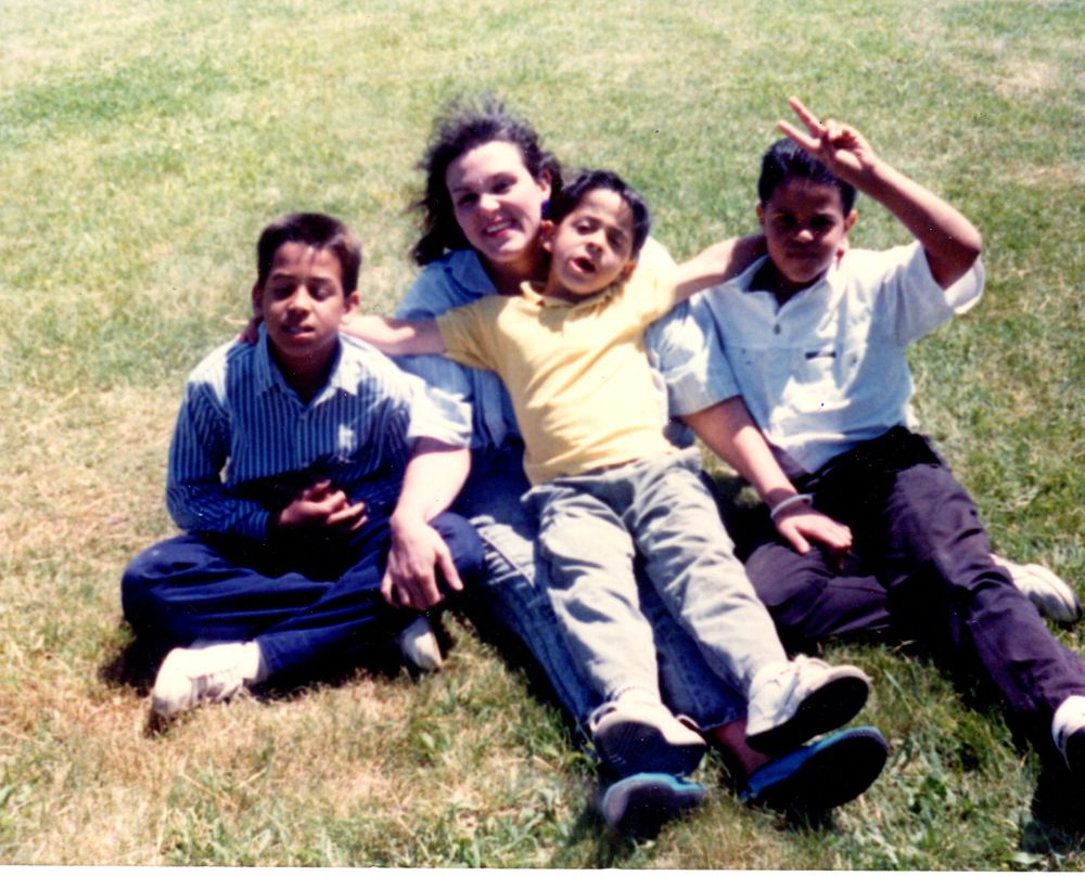 Mario Monteiro (center) with his mom and brothers, Jesse and Joe.