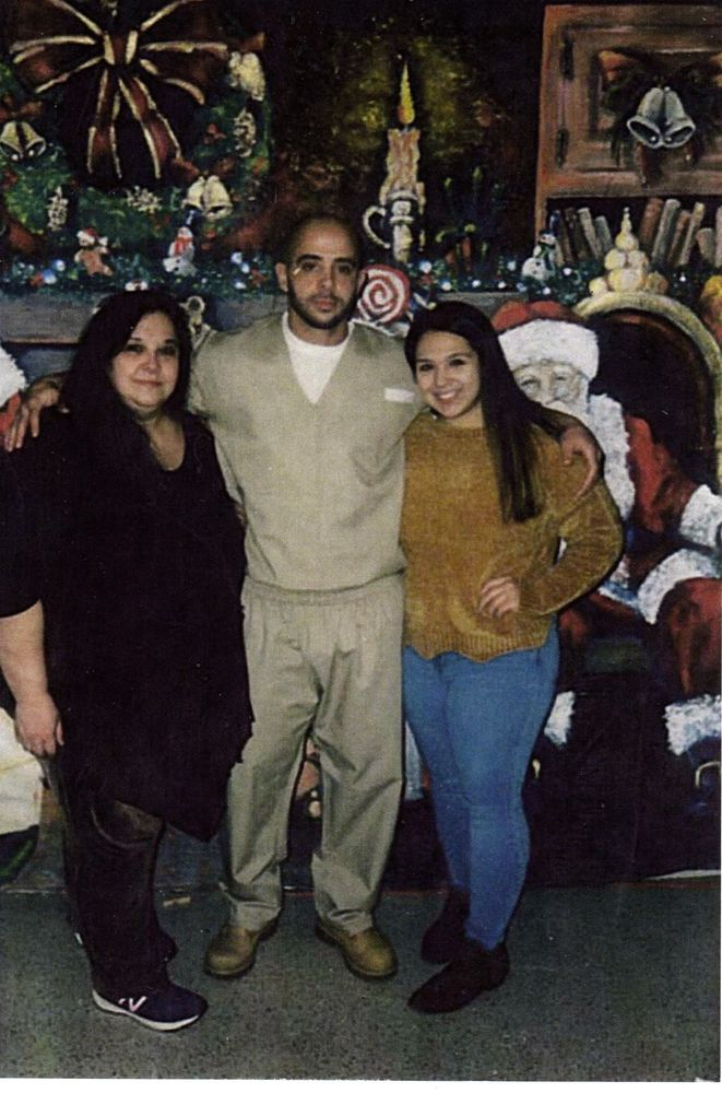 Mario Monteiro with his aunt, Jacqueline Pattison, and cousin, Anastasia, both of whom testified in support of the bill in 2019.