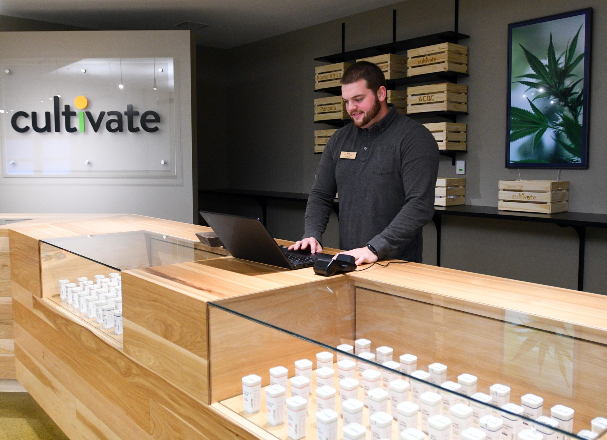 Ryan Green, patient advocate, works on his laptop at Cultivate Holdings Inc., in Leicester, the first medical marijuana dispensary to open in Worcester County and now the county's first recreational cannabis store expected to open Tuesday