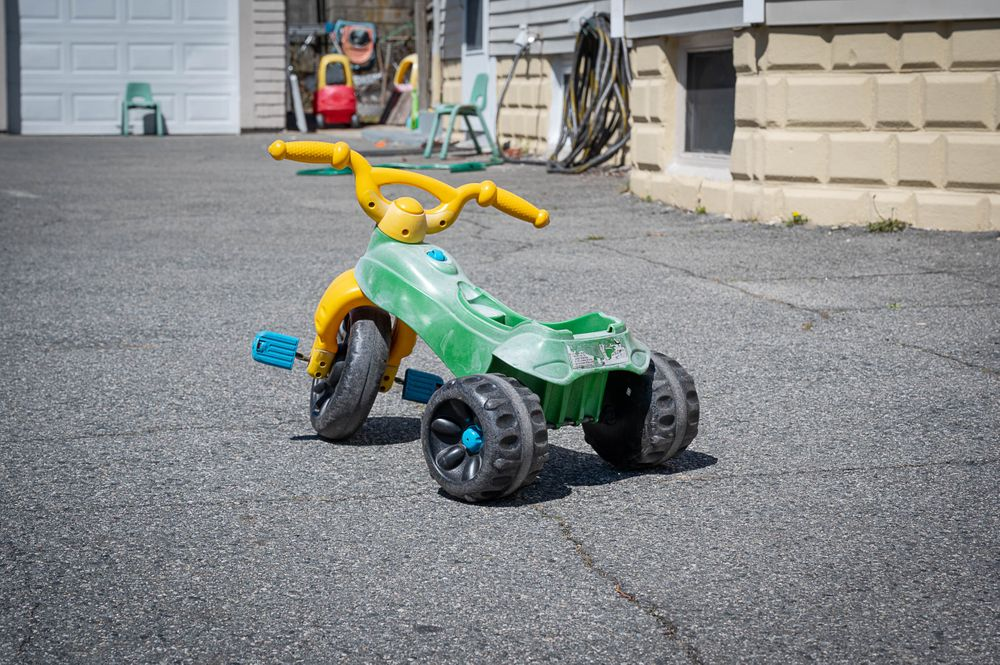 A tricycle sits outside a home-based child care in Providence.