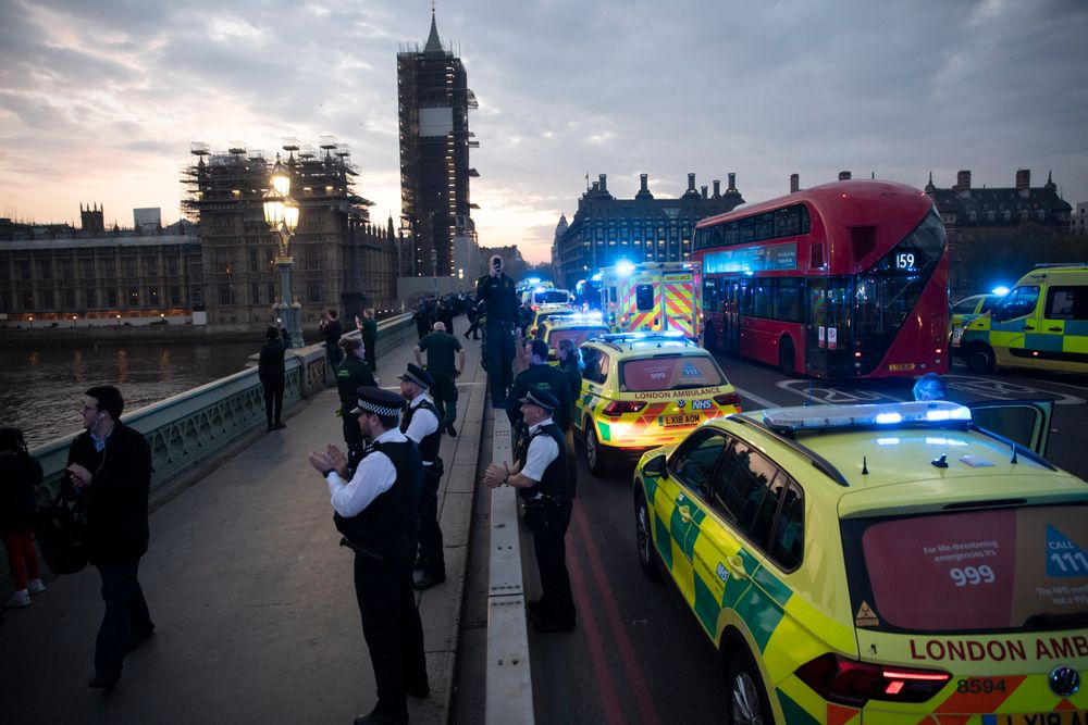 London Ambulance staff, police officers and firefighters take part in the weekly