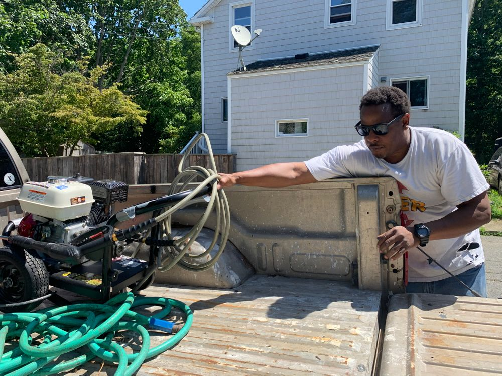 Lawrence Weldon unloads power washing equipment from his truck. He chose the name of his new business, Sunrise Power Washing, because it sounds pleasant and hopeful.