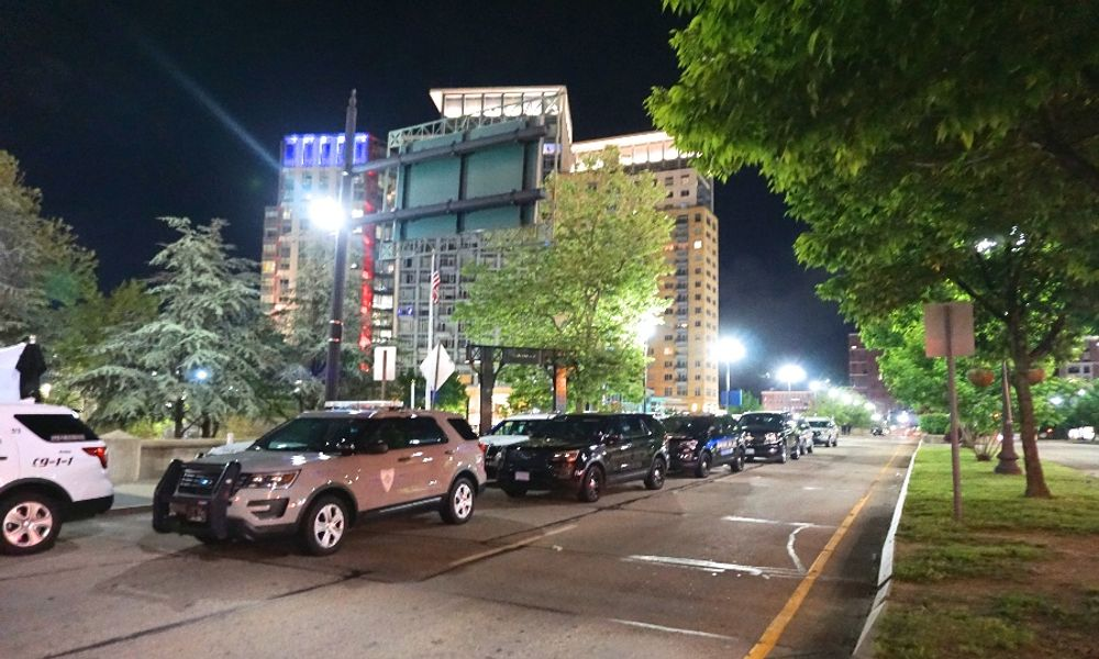 Police cars from across the state block Memorial Boulevard in downtown Providence