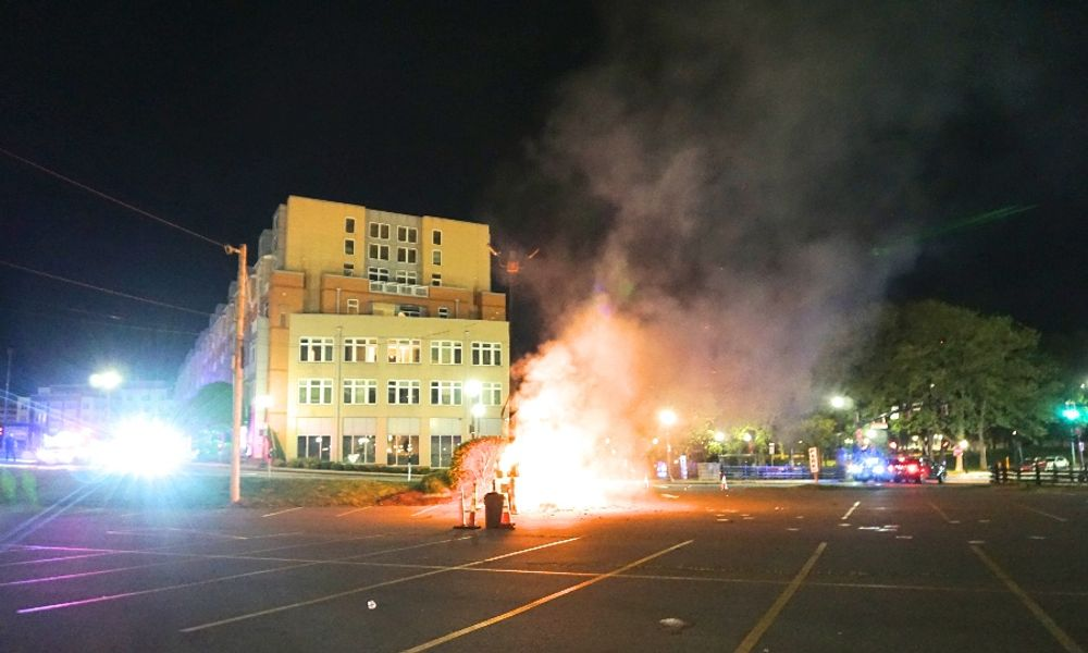 A parking shed burns in a downtown Providence parking lot