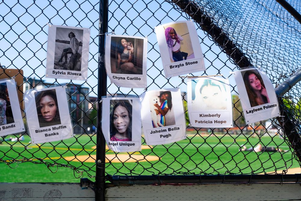 CORRECTS THAT PHOTOGRAPHS ARE OF TRANSGENDERED WOMEN KILLED OVER THE YEARS, NOT PEOPLE WHO DIED BY POLICE VIOLENCE - A backstop at Cal Anderson Park is covered, Tuesday, April 20, 2021, in Seattle, with photographs of transgendered women who have been killed in the past years.  (Dean Rutz/The Seattle Times via AP)