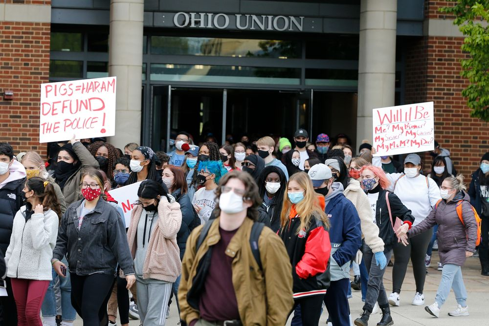 Students leave the Ohio Union on the campus of Ohio State University to protest the shooting of Ma'Khia Bryant a day earlier by Columbus Police, Wednesday, April 21, 2021, in Columbus, Ohio. (AP Photo/Jay LaPrete)