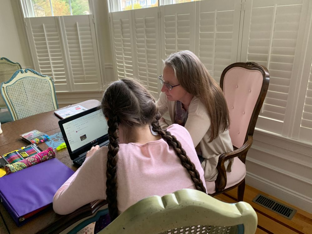 Annmarie Jurczak works with her daughter on lessons in their East Greenwich home