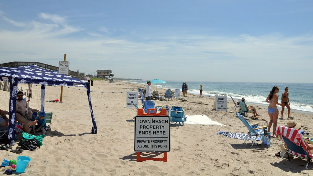 Beachgoers at the town line between Charlestown Town Beach and South Kingstown on June 27, 2020.