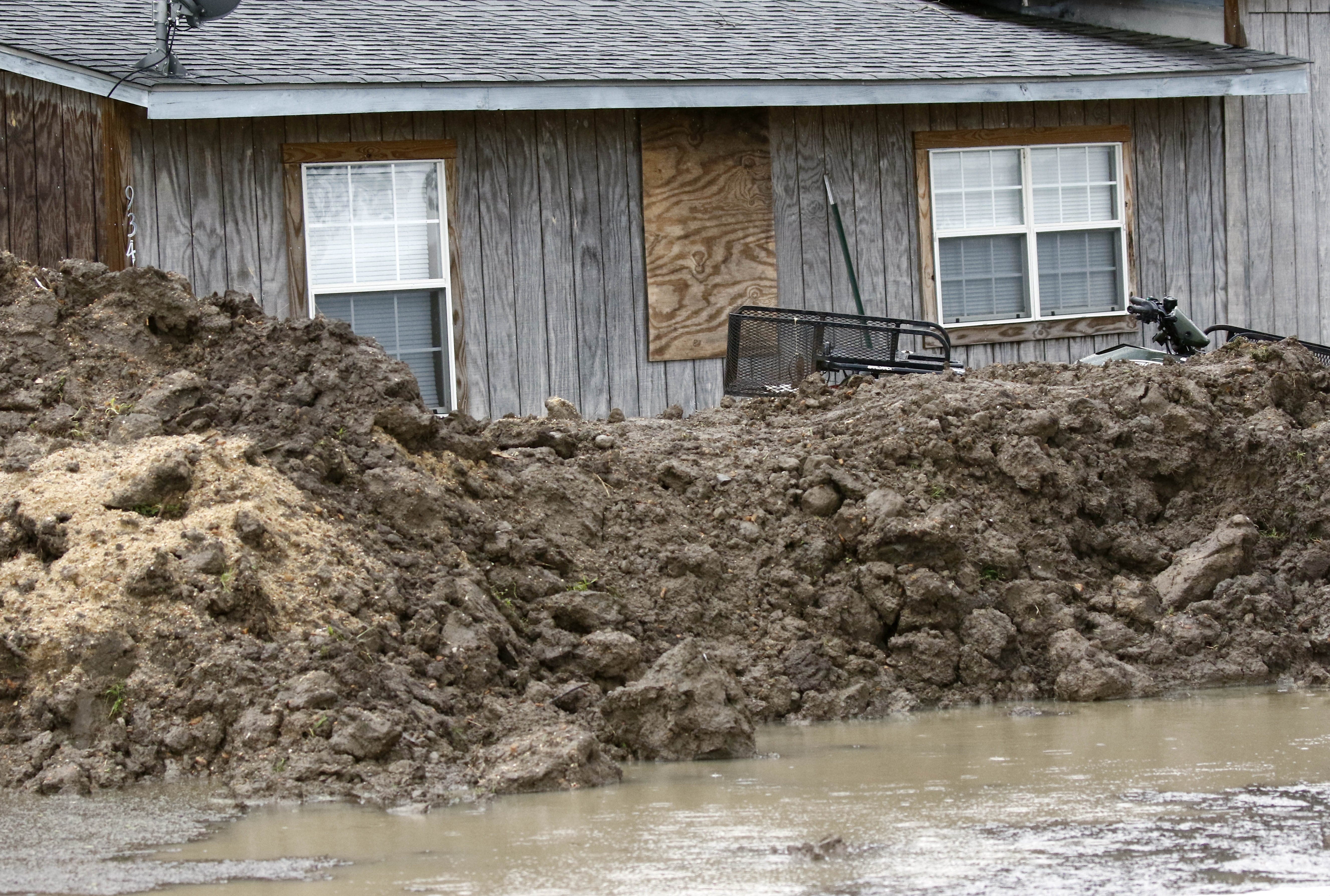 This March 11, 2019 photo shows a makeshift levee built by a resident in Rolling Fork, Miss., to protect his home from flood waters. In March 2019, scientists are warning that historic flooding could soon deluge parts of several southern states along the lower Mississippi River, where flood waters could persist for several weeks. (AP Photo/Rogelio V. Solis)