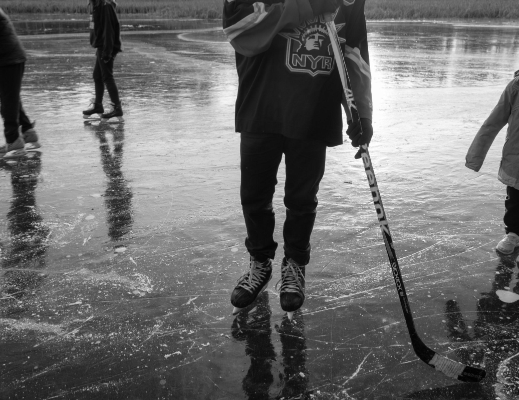 Black ice on a lake, fast-frozen with no snow, is a unique natural element.
