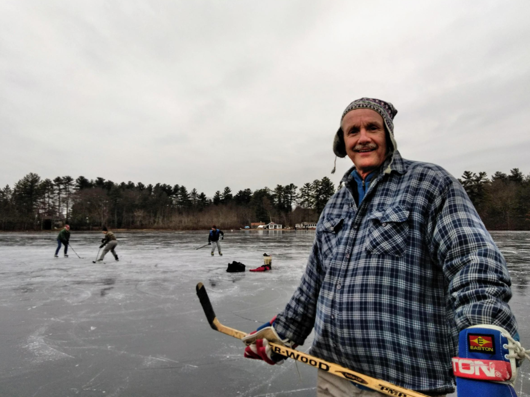 Massachusetts state geologist Steve Mabee, and UMass colleagues, marvel at the ice on Metacomet Lake in Belchertown, Massachusetts, on January 18, 2019.