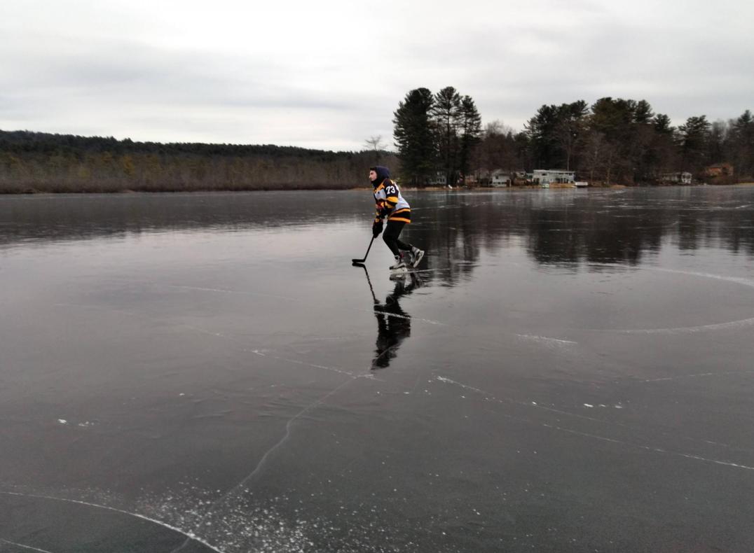 Raymond Langevin glides on the black ice on Metacomet Lake in Belchertown, Massachusetts.
