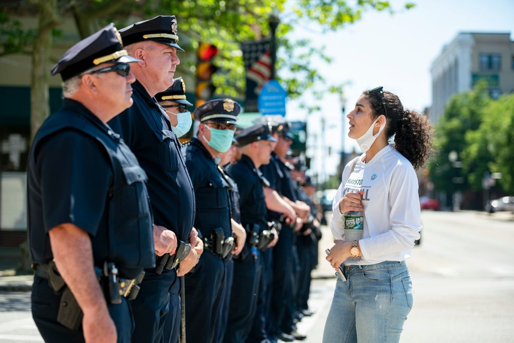 A protester speaks to police officers blocking off a street near the Government Center building in Fall River during a Black Lives Matter protest. (6-4-20)
