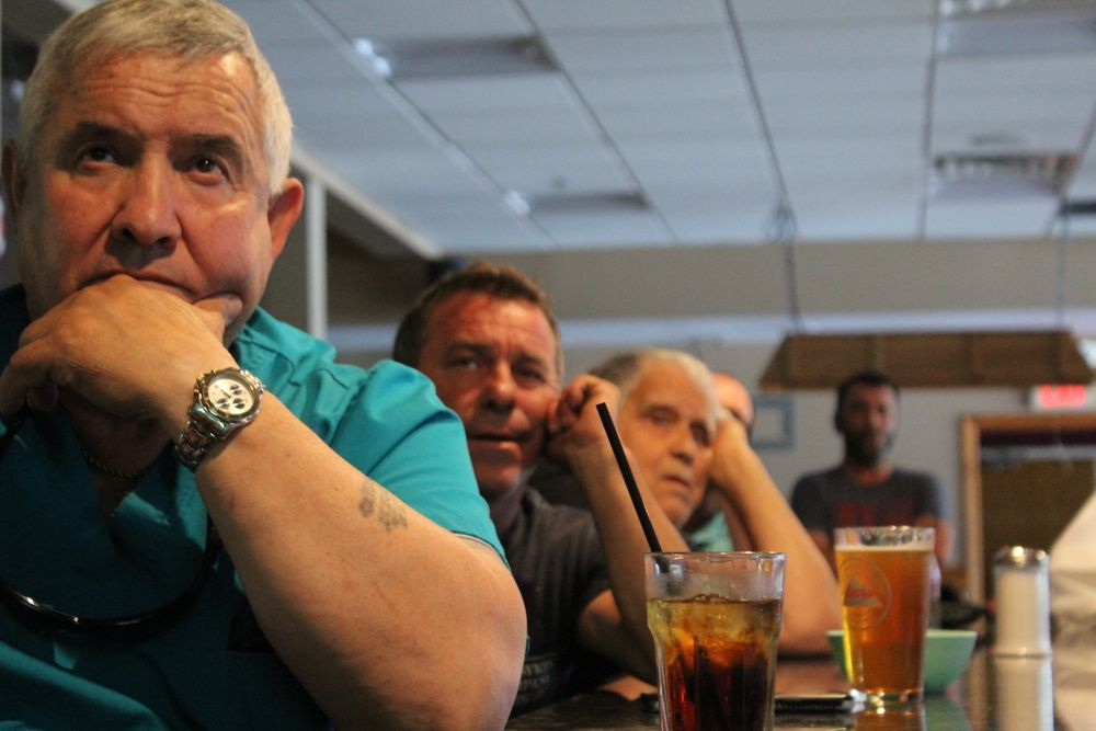 Members at the United Fishermen's Club watch the Portugal game on TV.