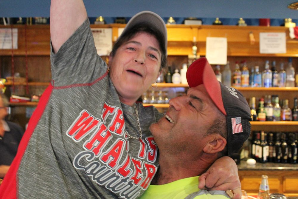 Fans celebrate at the New Bedford Sports Club.