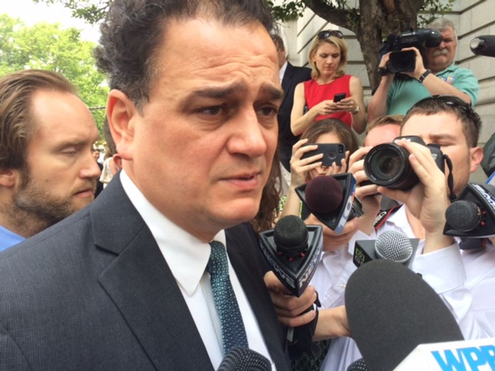 Gordon Fox speaking with reporters after his sentencing in 2015.