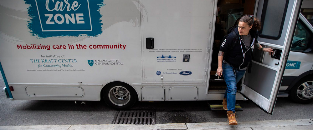 Sarah Mackin exits the Care Zone van after it parks on Haverhill Street near North Station. The outreach workers will mobilize and walk around the area to look for opioid users who need assistance.