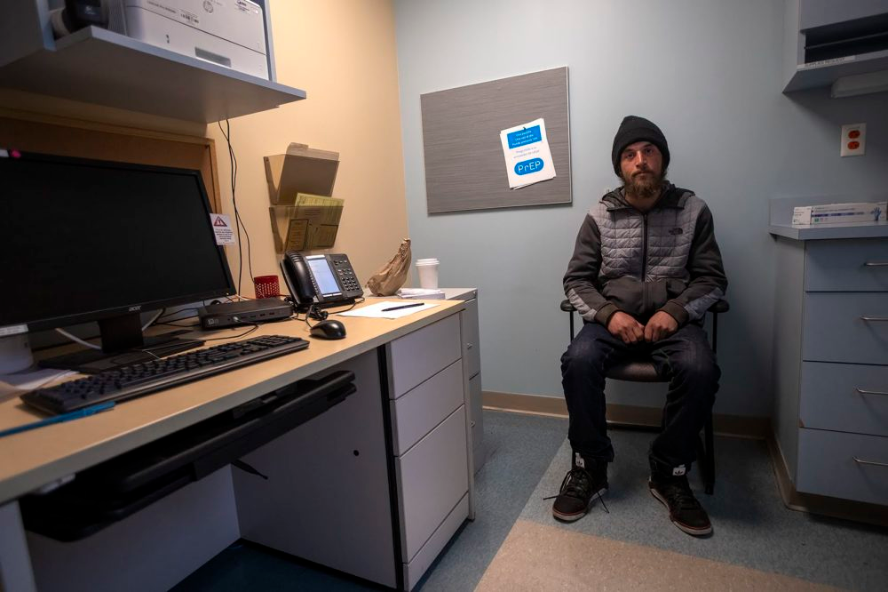 Cody waits in an exam room at Boston Health Care for the Homeless.