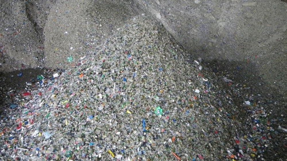 The mixed and crushed glass used to cover the landfill