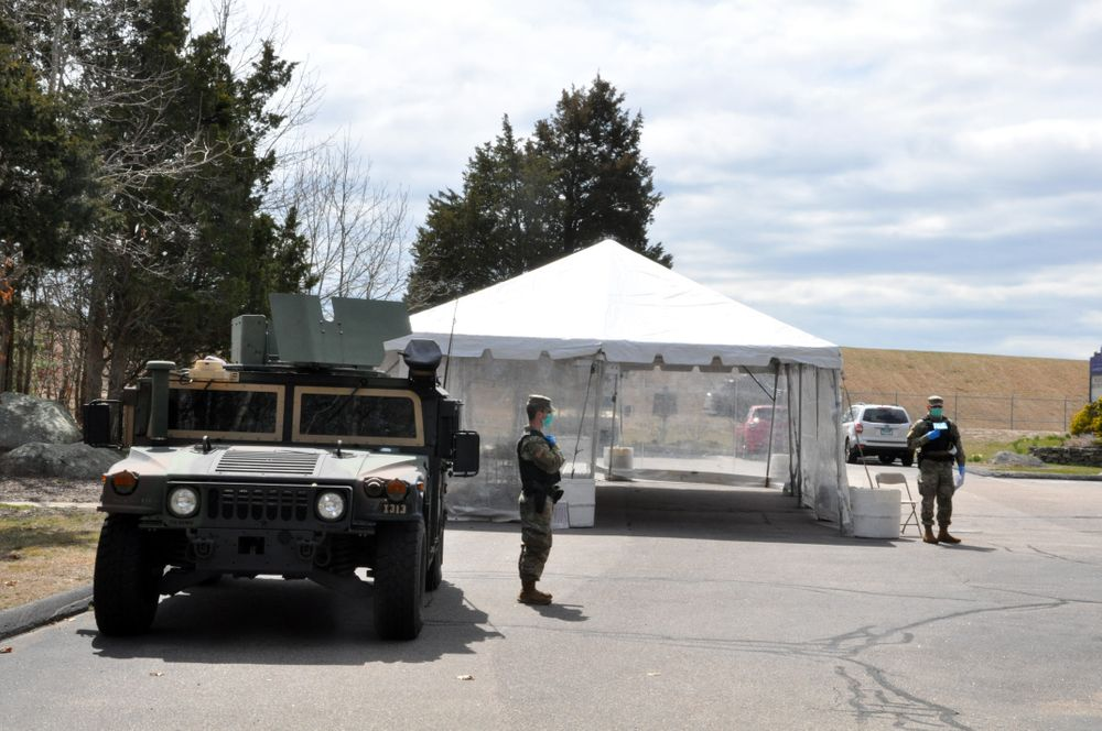 National Guard members wait for out-of-state motorists at a checkpoint on Route 1 in Westerly, R.I., Wednesday, April 1, 2020.