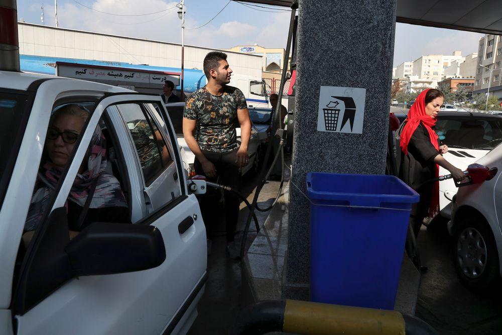 People fill their cars at a gas station in Tehran, Iran, Friday, Nov. 15, 2019. Authorities have imposed rationing and increased the prices of fuel. The decision came following months of speculations about possible rationing after the U.S. in 2018 reimposed sanctions that sent Iran's economy into free-fall following Washington withdrawal from 2015 nuclear deal between Iran and world powers. (AP Photo/Vahid Salemi)