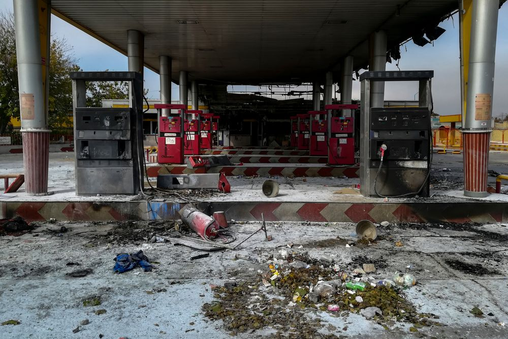 This photo released by the Iranian Students' News Agency, ISNA, shows a gas station that was burned during protests that followed authorities' decision to raise gasoline prices, in Tehran, Iran, Sunday, Nov. 17, 2019.  Ayatollah Ali Khamenei, Iran's supreme leader on Sunday backed the government's decision to raise gasoline prices and called angry protesters who have been setting fire to public property over the hike